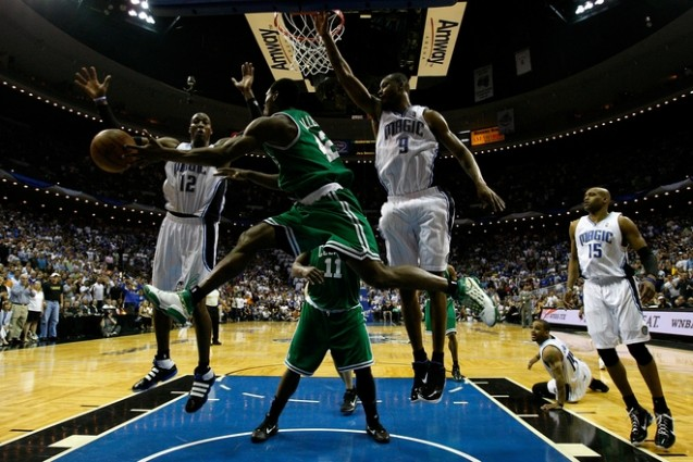 Tony Allen (42) of the Boston Celtics passes the ball as he is defended by Dwight Howard (12), Rashard Lewis (9) and Vince Carter (15) of the Orlando Magic in Game Two of the Eastern Conference Finals during the 2010 NBA Playoffs at Amway Arena on May 18, 2010 in Orlando, Florida. Getty Images / Kevin C. Cox ........