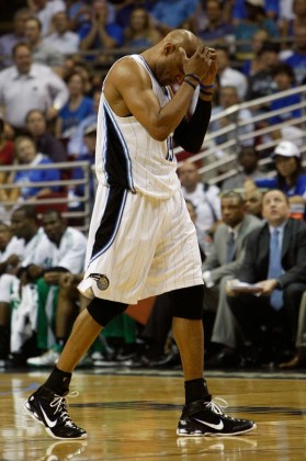 Vince Carter (15) of the Orlando Magic walks towards the bench with his head down against the Boston Celtics in Game Two of the Eastern Conference Finals during the 2010 NBA Playoffs at Amway Arena on May 18, 2010 in Orlando, Florida. Getty Images/ Doug Benc ............