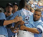 B J Upton has to be restrained by his teammates in the dugout after a flare up between he and third baseman Evan Longoria in a game against the Arizona Diamondbacks . Associated Press/ Mike Carlson .........