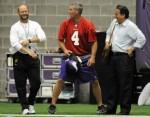 Minnesota Vikings quarterback Brett Favre, center, talks with head coach Brad Childress, left, and and former NFL coach Steve Mariucci during NFL football training camp Wednesday, Aug. 19, 2009, in Eden Prairie, Minn. AP / Hannah Foslien ..............