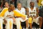 LA Lakers guard Kobe Bryant (R) returns to the bench after a foul before the Boston Celtics went on to win 103-94 in game two of the NBA finals at the Staples Center in Los Angeles on June 6, 2010. The defending champion Los Angeles Lakers are not only seeking their 16th NBA championship but also redemption after a humbling loss to the Boston Celtics in the 2008 NBA finals. The Lakers still have the bitter after taste of their humiliating finals loss two years ago. Seated alongside Bryant are Jordan Farmar (center) and Lamar Odom (left). AFP /Getty Images/ Mark Ralston .......