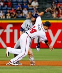 Carl Crawford (13) of the Tampa Bay Rays slides safely into second base under the tag of Martin Prado (14) of the Atlanta Braves at Turner Field on June 15, 2010 in Atlanta, Georgia. Getty Images/ Kevin C Cox