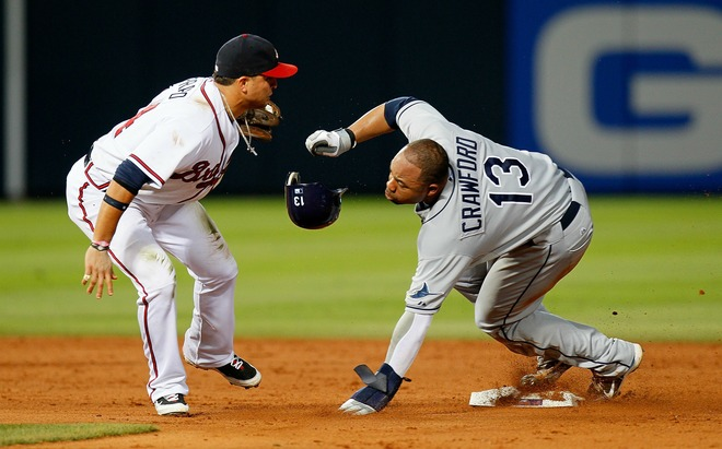 Martin Prado of the Atlanta Braves tags out a sliding Carl Crawford of the Tampa Bay Rays at second base at Turner Field on June 17, 2010 in Atlanta, Georgia. Getty Images/ Kevin C Cox