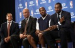 LeBron James smiles as he's introduced to the crowd at St. Vincent-St. Mary High School with owner Dan Gilbert, left, general manager Danny Ferry, second from the left, and coach Mike Brown, second from the right. The Plain Dealer / Gus Chan ...........
