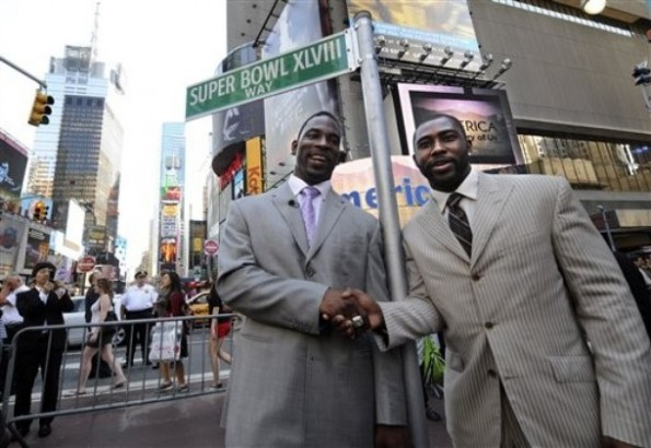New York Giants Justin Tuck, left, and New York Jets Darrelle Revis pose for photographers in Times Square, Tuesday, May 25, 2010, in New York. NFL owners voted on Tuesday to play the February 2014 Super Bowl in the new $1.6 billion Meadowlands Stadium that's about to become home to the Jets and Giants. AP Photo/ Louis Lanzano ..........