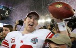 Superbowl MVP Eli Manning is all smiles having led his team to an improbable victory over the then unbeaten New England Patriots. courtesy of Associated Press/ Mark Strong ....