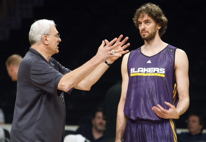 Coach Phil Jackson and Pau Gasol talk during a Los Angeles Lakers practice session as they prepare to meet the Boston Celtics in Game 7 of the NBA basketball Finals, at Staples Center in Los Angeles Wednesday, June 16, 2010. (AP Photo/Reed Saxon)