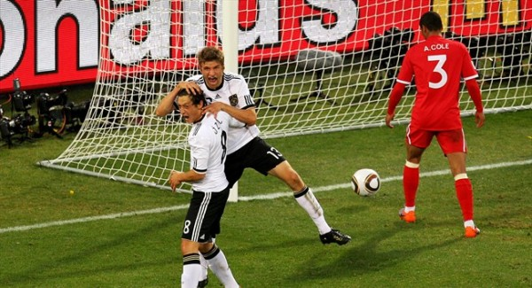 Mesut Ocil (8) of Germany and his teammate Thomas Muller (13) celebrate Muller's goal against England during their knockout phase game played in Free State Stadium, Bloemfontein , South Africa. Germany would go on to rout England 4-1 thereby making it to the quarter finals of the World Cup. Getty Images/ Cameron Spencer ...........