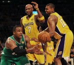 Boston Celtics forward Glen Davis (L) unloads the ball covered under the net by Los Angeles Lakers forward Lamar Odom (C) and Lakers guard Andrew Bynum (R) during game 6 of the NBA Finals against the Los Angeles Lakers June 15, 2010 at the Staples Center in Los Angeles. AFP/Getty Images/ J Richards