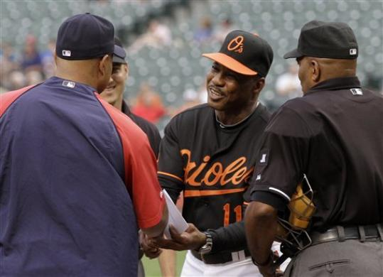 Baltimore Orioles interim manager Juan Samuel, right, exchanges lineups with Boston Red Sox bench coach DeMarlo Hale, left, before the start of a baseball game, Friday, June 4, 2010, in Baltimore. AP / Rob Carr ..............