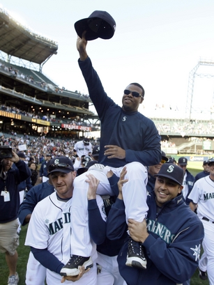 Seattle Mariners' Ken Griffey Jr. is carried around the field by Ryan Langerhans, left, and Matt Tuiasosopo, right, after the Mariners' 4-3 win over the Texas Rangers in a baseball game in Seattle on Sunday, Oct. 4, 2009. Griffey has said he would be interested in playing another season if the team wants him. AP Photo/John Froschauer ...