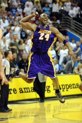 Kobe Bryant (24) of the Los Angeles Lakers celebrates after defeating the Orlando Magic 99-86 in Game Five of the 2009 NBA Finals on June 14, 2009 at Amway Arena in Orlando, Florida. The Los Angeles Lakers look to win the NBA Finals for the second year in a row as they take on the Boston Celtics starting with Game One on June 3 in Los Angeles. The Celtics last won the NBA Finals in 2008 by defeating the Lakers 4 - 2 . Getty Images / Ronald Martinez ..............