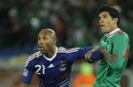 France's striker Nicolas Anelka (L) and Mexico's defender Francisco Rodriguez eye the ball during the Group A first round 2010 World Cup football match France vs. Mexico on June 17, 2010 at Peter Mokaba stadium in Polokwane. Mexico would defeat France 2-0 in one of the shock results of the World Cup so far. AFP /Getty Images/ Fernando Montez ..........