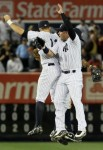 Nick Swisher (33), Brett Gardner (11), and Curtis Granderson (14) of the New York Yankees celebrate after defeating the Philadelphia Phillies on June 15, 2010 at Yankee Stadium in the Bronx borough of New York City. The Yankees defeated the Phillies 8-3. Getty Images/ Jim McIsaac