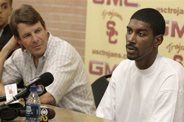 Southern California basketball player O.J. Mayo, right, speaks to reporters as coach Tim Floyd listens in Los Angeles. Louis Johnson, a former associate of Mayo, who is now in the NBA, has told Yahoo! Sports thatFloyd paid to help get Mayo to play for the Trojans. Floyd declined to comment to Yahoo! about the accusations by Johnson. AP Photo/Nick Ut .................