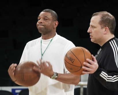 Boston Celtics coach Doc Rivers, left, and assistant coach Tom Thibodeau watch the Celtics practice as they prepare to meet the Los Angeles Lakers in Game 7 of the NBA basketball Finals, at Staples Center in Los Angeles on Wednesday, June 16, 2010. (AP Photo/Reed Saxon)