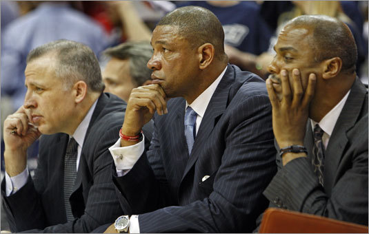 """Thibodeau (left) is seen here alongside Celtics' coach Doc Rivers (center) and assistant coach Armond Hill (right). Thiboideau is often thought of as a """"defense guru"""" and is the architect of the Celtics' much lauded defensive schemes and play. courtesy of the Boston Globe / Jim Davis ............"""