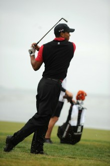 American Tiger Woods hits on the 18th hole fairway at the 110th U.S. Open at Pebble Beach Golf Links at the US Open golf championship in Pebble Beach, California on June 20, 2010. AFP/ Getty Images/ Robyn Beck