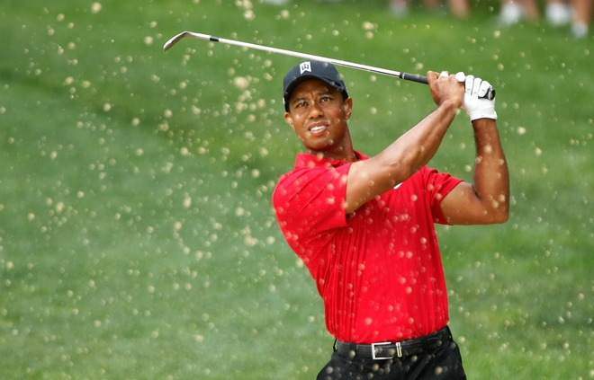 Tiger Woods plays a bunker shot on the first hole during the final round of the Memorial Tournament presented by Morgan Stanley at Muirfield Village Golf Club on June 6, 2010 in Dublin, Ohio. Getty Images/ Scott Halleran ............