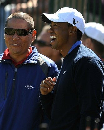 Tiger Woods (R) of the US laughs with an unidentified man while practicing on the driving range on the last preview day prior to the start of the 110th U.S. Open at Pebble Beach Golf Links at the US Open golf championship in Pebble Beach, California on June 16, 2010. AFP/Getty Images/ Robyn Peck