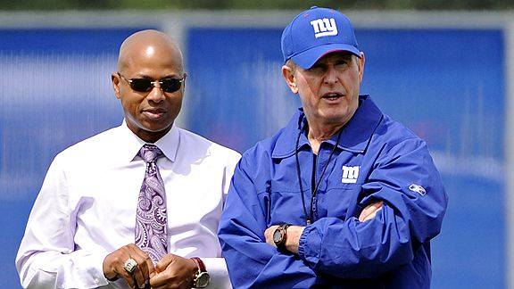 Tom Couhglin (right) is seen here with team General Manager Jerry Reese. The two have been the architect of the Giants' Superbowl winning roster and are thought to have had a very poductive 2010 NFL Draft procurement of players. courtesy of Associated Press/ Bill Carpenter