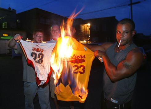 Upset with the most recent of Cleveland sports tragedies, Cavaliers fans, from left, Josh Hall, Rob Hose, and Mike Adams set fire to LeBron James jerseys. Associated Press / Phil Matuzzo ..........