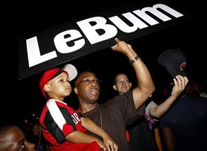 Thomas Johnson, of Bridgeport, Conn., holding his son Thomaj, 4, shows his feelings outside the Boys & Girls Club in Greenwich, Conn., Thursday July 8, 2010 after free-agent basketball player LeBron James announced he will join the Miami Heat and leave the Cleveland Cavaliers. AP Photo/Craig Ruttle