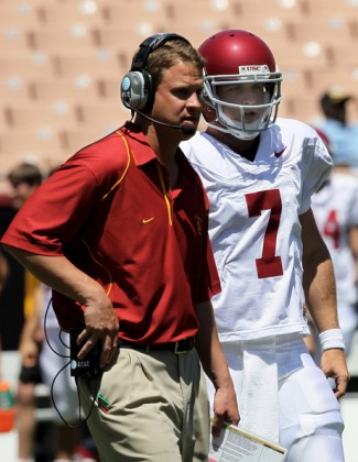 Head coach Lane Kiffin talks with quarterback Matt Barkley #7 during the USC Trojans spring game on May 1, 2010 at the Los Angeles Memorial Coliseum in Los Angeles, California. Stephen Dunn /Getty Images North America ................