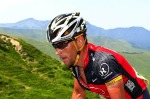 US Lance Armstrong climbs the Cold d'Aubisque pass during the 199,5 km and 16th stage of the 2010 Tour de France cycling race run between Bagneres-de-Luchon and Pau, Southwestern France, on July 20, 2010. AFP PHOTO / JOEL SAGET ........