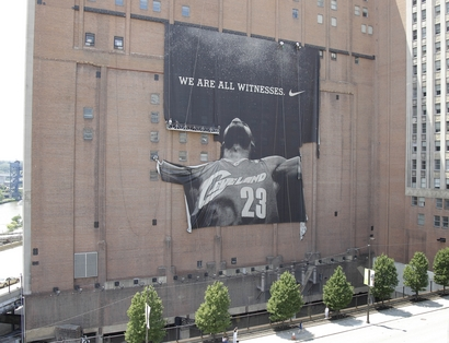 Workers are set to remove the giant banner of former Cleveland Cavaliers NBA basketball star LeBron James in downtown Cleveland, Ohio on Sunday, July 11, 2010. On Thursday night, James announced in a televised special that he would be signing a contract for the upcoming season to join the Miami Heat. (AP Photo/Amy Sancetta)