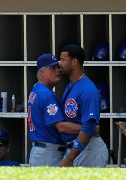 Manager Lou Piniella #41 of the Chicago Cubs talks with Derrek Lee #25 after Lee had a confrontation with starting pitcher Carlos Zambrano in the dugout during a game against the Chicago White Sox at U.S. Cellular Field on June 25, 2010 in Chicago, Illinois. June 24, 2010 - Photo by Jonathan Daniel/Getty Images North America