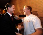 Lane Kiffin (L) new college football coach of University of Southern California greets quarterback Matt Barkley after arriving at Heritage Hall on the campus of USC for a news conference on January 13, 2010 in Los Angeles, California. Kevork Djansezian/Getty Images North America