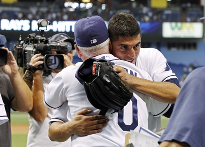 """Tampa Bay Rays starting pitcher Matt Garza , right, is congratulated by manager Joe Maddon after Garza threw a """"no-hitter"""" in a baseball game against the Detroit Tigers on Monday, July 26, 2010, in St. Petersburg, Fla. AP Photo/Mike Carlson ......."""