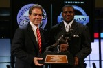 Running back Mark Ingram (R) #22 of the Alabama Crimson Tide poses with Head coach Nick Saban (L) and the Heisman Trophy during a press conference after being named the 75th Heisman Trophy winner at the Marriott Marquis on December 12, 2009 in New York City. Photo by Chris Trotman/Getty Images North America ...
