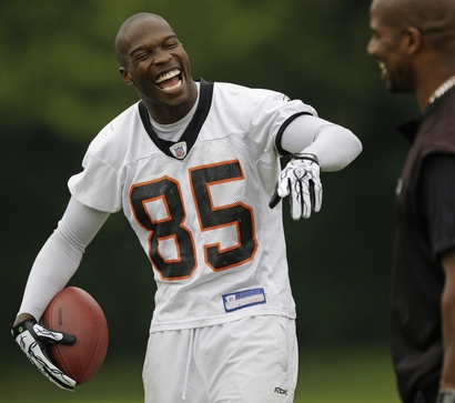 Cincinnati Bengals wide receiver Chad Ochocinco (85) laughs with Eric Ball during the NFL football team's first practice, Thursday, July 29, 2010, in Georgetown, Kentucky. AP Photo/Al Behrman ......