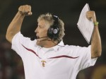 Pete Carroll seen here triumphant in yet another game for the USC Trojans . The fallout concerning the football program has led to NCAA sanctions , the foregoing of bowl appearances and the possibility of Heisman Trophy winner Reggie Bush returning his accolade. GNI/ Matt Scheur