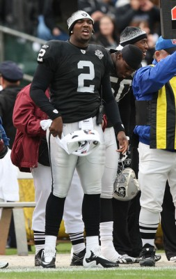 JaMarcus Russell (2) of the Oakland Raiders looks on from the bench against the Cincinnati Bengals during an NFL game at Oakland-Alameda County Coliseum on November 22, 2009 in Oakland, California. November 21, 2009 - Photo by Jed Jacobsohn/Getty Images North America .....