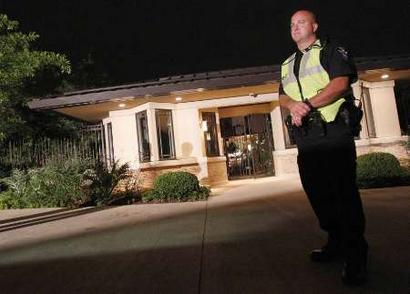 A Bath Township police officer stands guard at the front gate of the home of NBA player LeBron James(notes) in Bath, Ohio, a suburb of Cleveland, July 8, 2010. James confirmed on Thursday he would be leaving the Cleveland Cavaliers to join the Miami Heat next season. REUTERS/Aaron Josefczyk