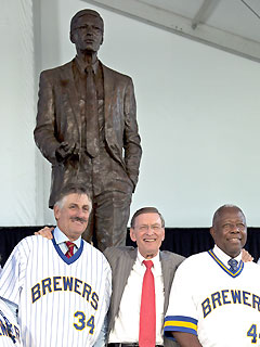 Selig (center) is seen here alongside Hall of Famers Hank Aaron (right) and Rollie Fingers (left) outside Miller Park , Milwaukee at the unveiling of a statue to honor Selig and his commitment to the Milwaukee Brewers , the team he once owned before assuming the role as MLB Commissioner . courtesy AFP/ Reuters / Chris Parker