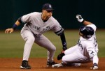 Outfielder Carl Crawford (13) of the Tampa Bay Rays steals his 400th career base as shortstop Derek Jeter #2 of the New York Yankees is late with the tag during the game at Tropicana Field on July 31, 2010 in St. Petersburg, Florida. Getty Images/ J . Meric ......