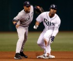 Outfielder Carl Crawford (13) of the Tampa Bay Rays steals his 400th career base as shortstop Derek Jeter #2 of the New York Yankees is late with the tag during the game at Tropicana Field on July 31, 2010 in St. Petersburg, Florida. Getty Images/J Meric .........