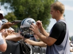 Carolina Panthers quarterback Jimmy Clausen(notes) signs autographs after practice at the NFL football team's training camp in Spartanbrug, S.C., Thursday, July 29, 2010. AP photo Chuck Barton