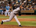 New York Yankees reliever Kerry Wood pitches against the Tampa Bay Rays during the eighth inning of a baseball game Sunday, Aug. 1, 2010, in St. Petersburg, Fla. The Rays defeated the Yankees 3-0. Associated Press / Steve Nesius ......