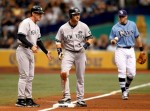 Outfielder Nick Swisher (3)3 of the New York Yankees advances to third against the Tampa Bay Rays during the game at Tropicana Field on August 1, 2010 in St. Petersburg, Florida. Getty Images/ J. Meric .....