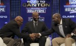 Floyd Little shakes hands with Emmitt Smith as Jerry Rice looks on after the announcement that the three former NFL stars are being inducted into the Pro Football Hall of Fame. AP photo Wilfredo Lee ..........