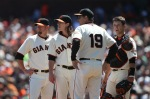Pitcher Tim Lincecum (55) of the San Francisco Giants looks on with Aubey Huff (17), Dave Righetti (19) and catcher Buster Posey(28) against the San Diego Padres in the second innning during an MLB game at AT&T Park on August 15, 2010 in San Francisco, California. Jed Jacobsohn /Getty Images .....