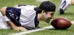 Cowboys' quarterback Tony Romo stretches during training camp . courtesy of Associated Press / Eric Gay ....