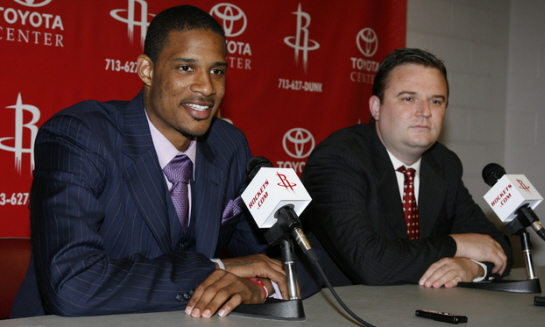 Trevor Ariza speaks at a press conference after signing with the Houston Rockets as Rockets GM Daryl Morey looks on at the Toyota Center on July 8, 2009 in Houston, Texas. courtesy of NBAE/Getty Images/ Bill Baptiste