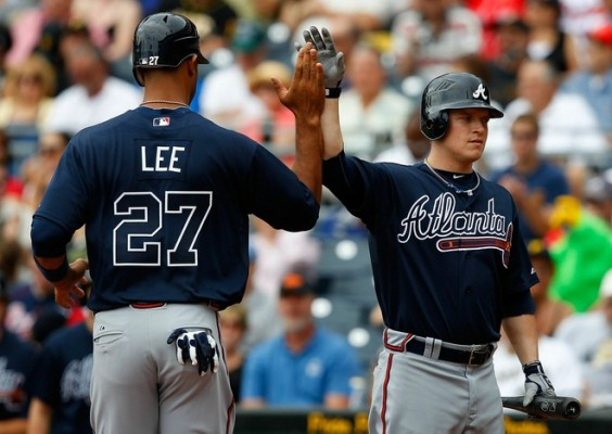 Derrek Lee (27) of the Atlanta Braves is congratulated by teammate Nate McLouth (24) after scoring in the second inning against the Pittsburgh Pirates during the game on September 6, 2010 at PNC Park in Pittsburgh, Pennsylvania. Jared Wickerham/Getty Images ....