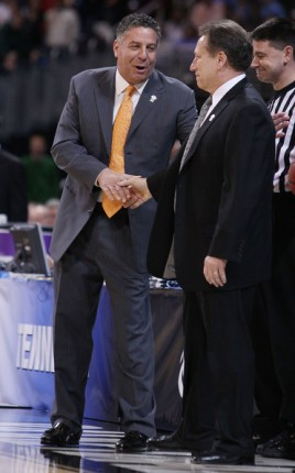 Head coach Bruce Pearl (left) of the Tennessee Volunteers and Tom Izzo of the Michigan State Spartans shake hands before the game during the midwest regional final of the 2010 NCAA men's basketball tournament at the Edward Jones Dome on March 28, 2010 in St. Louis, Missouri. Elsa Martinez / Getty Images